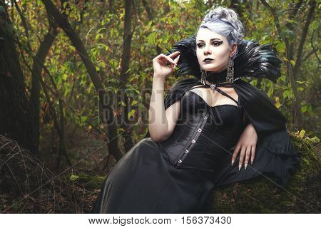 Beautiful young woman a witch she was in the dark forest.