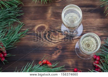 Christmas Seasonal Background With Champaign, Pine Branches, Red Berries