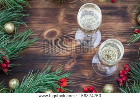 Christmas Holiday Wooden Composition With Champaign, Pine Branches, Red Berries