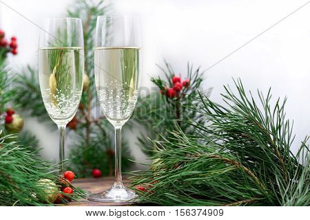 Christmas Holiday Still-life Of With Champaign, Pine Branches, Red Berries