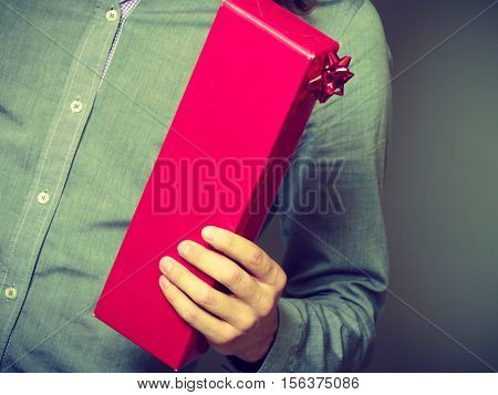Guy Holding Present Red Gift Box