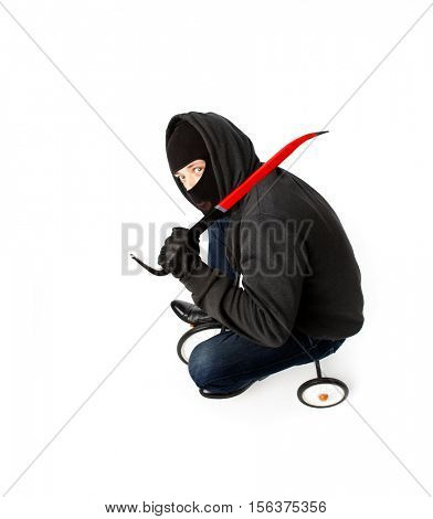 Burglar going with lock pick