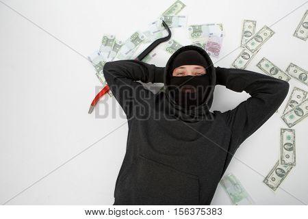 Satisfied burglar lies on floor