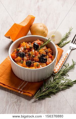 ratatouille with pumkin capers potatoes and black olives