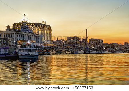 Kiev Ukraine - August 9 2016: View on the river bank of Poshtova Square and River Station at sunset. Tourists like to take a boat here and have an excursion.