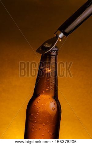 Fresh Cold Beer Ale Bottle With Drops And Stopper Open With Bottle Opener