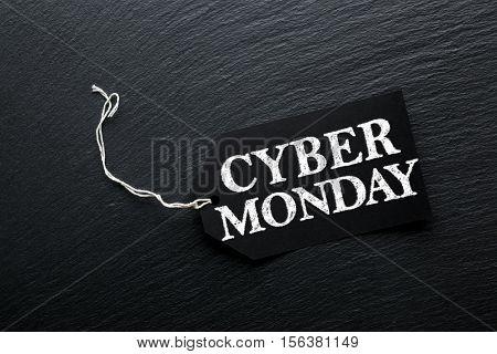 Cyber Monday Sale tag on dark slate background