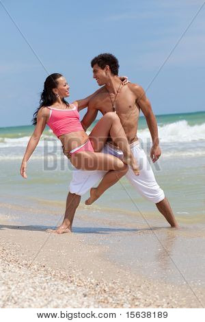 posing beautiful couple on the sea beach
