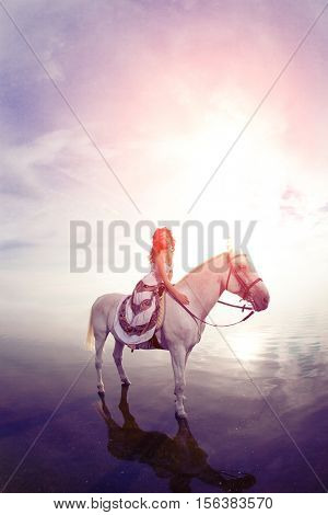 Beautiful woman on a horse. Horseback rider, woman riding horse on beach.
