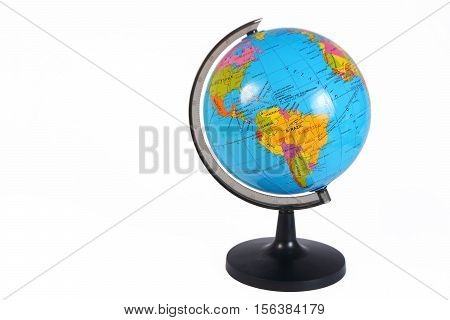 Photo image of an earth globe on white background with some empty space