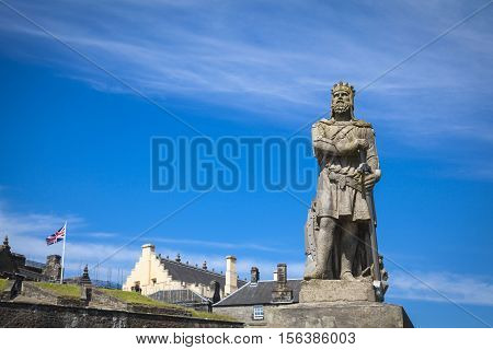 Robert the Bruce king of Scots; stone statue in front of Stirling castle. Scotland