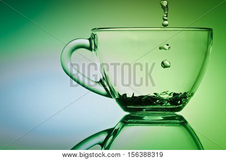 Drop Of Water Falling Down To Cup Of Tea