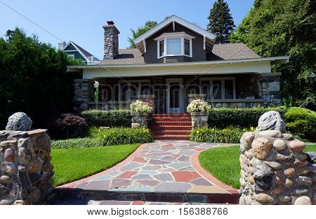 HARBOR SPRINGS, MICHIGAN / UNITED STATES - AUGUST 3, 2016: An elegant home made of stone and brick, across from the Zorn Park Beach in Harbor Springs.
