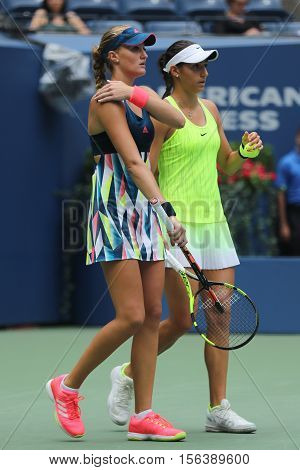 NEW YORK - SEPTEMBER 11, 2016: Kristina Mladenovic (L) and Caroline Garcia of France in action during US Open 2016 women doubles final match at the Billie Jean King National Tennis Center