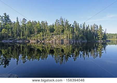Morning Reflections in Canoe Country on Sidney Lake of Quetico Provincial Park in Ontario