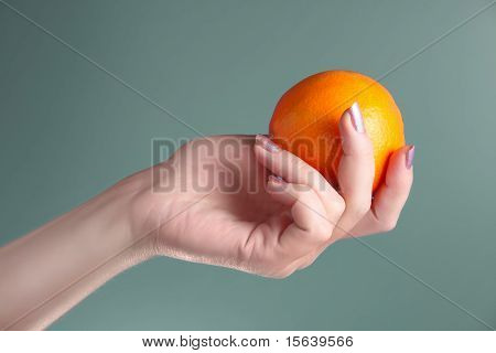 Woman Holds In Her Hand Oranges
