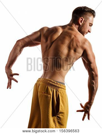Bodybuilder posing on a white background. Athlete isolated. Drying. Relief and sculptural muscles of the body. Healthy lifestyles concept. The muscles of the back and arms.