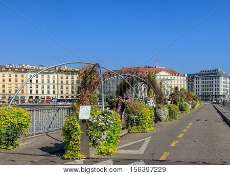Geneva, Switzerland - 24 September, 2016: view along the Pont des Bergues bridge buildings along the Rhone river in the background. The city of Geneva is the capital of the Swiss Canton of Geneva.