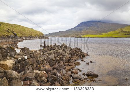 Stones at the shore of Loch Assynt Highlands Lairg Scotland