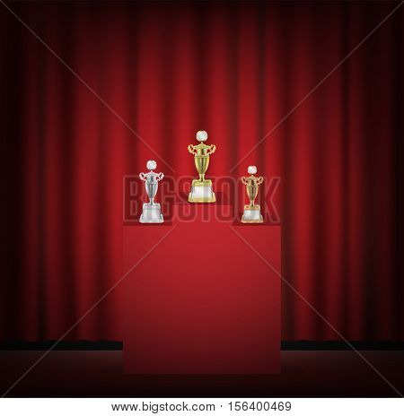 Gold silver bronze trophy on a stage with red curtain backgrond