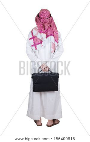 Behind view of arabian entrepreneur standing in the studio while carrying a briefcase isolated on white background