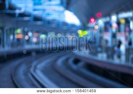Blurry image of high-speed bullet train station in evening