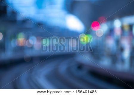 ฺBlurry image of high-speed bullet train station in evening