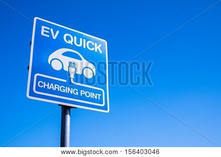 Charging station for electric vehicle sign in parking area
