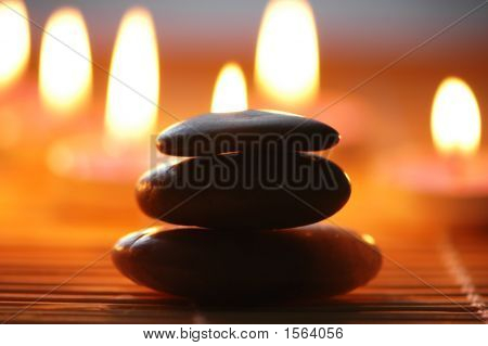Stack Of Stone And Candles At The Backrgound