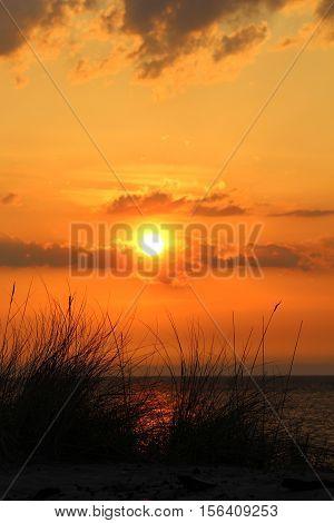Orange sunset over Portage Lake in Michigan