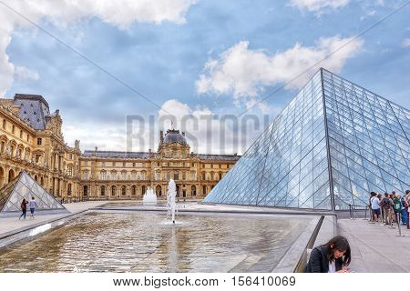 Paris, France - July 03, 2016 :glass Pyramid And The Louvre Museum. The Louvre Is The Biggest Museum
