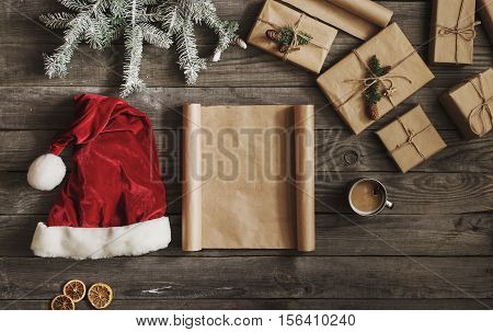 Blank sheet of old paper on wooden table with Christmas objects top view