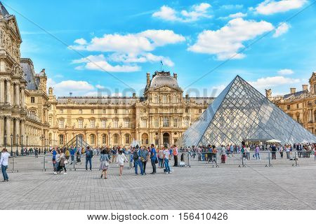 Paris, France - July 06, 2016 : Glass Pyramid And The Louvre Museum With People (tourists). The Louv