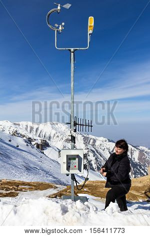 The meteorologist working at a weather station in the mountains