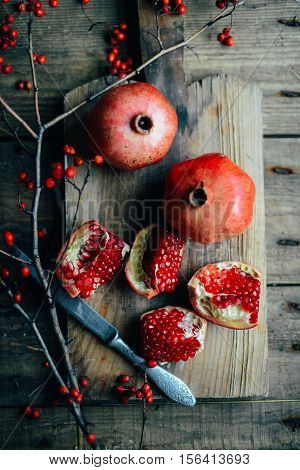 Fresh Red Pomegranate And Grapefruit On A Wooden Background. Pom
