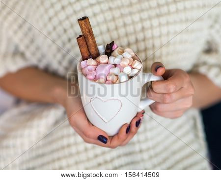 Woman Hands Holding A Cup Of Hot Chocolate With Marshmallows