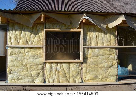 insulated wooden house wall with mineral rock wool construction