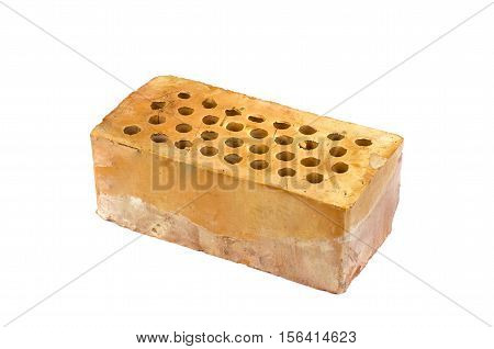 One red clay brick with holes isolated on white background