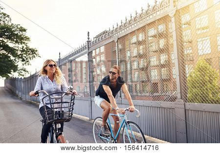 Young Couple Going For A Summer Bicycle Ride