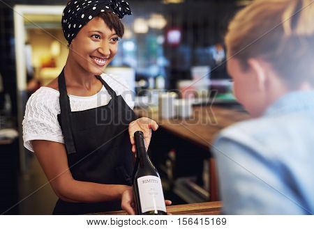 Smiling Waitress Or Bartender Showing Red Wine