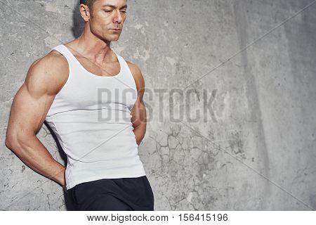 Close up fitness concept portrait of white man fit and healthy white tanktop fitness concept