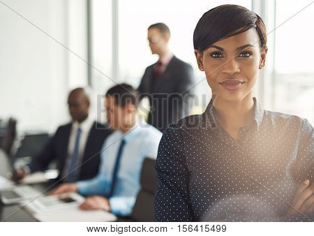 Young Business Owner In Office With Employees