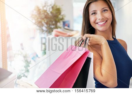 Happy Pretty Young Woman With Her Purchases