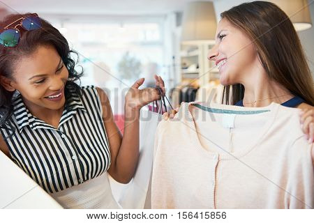 Happy Young Female Friends Choosing A Garment
