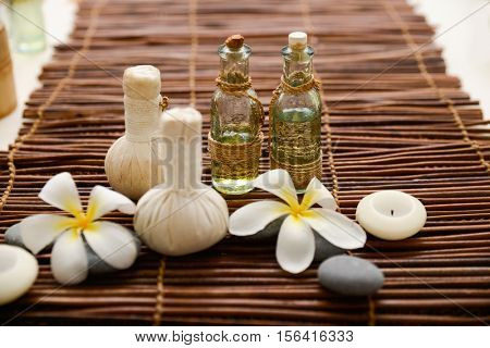 frangipani with massage oil and herbal compress balls ,candle on mat herbal compress balls