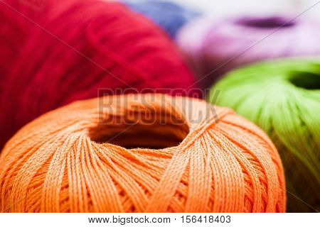 Colorful balls of yarn background, close-up of bright knitting threads, Handiwork, leisure, hobby concept