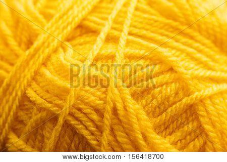 Orange knitting thread texture, handiwork backdrop. Bright handiwork background, crochet woolen string, Leisure, hobby, needlework concept