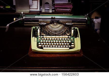 Ancient typewriter on the table in vintage