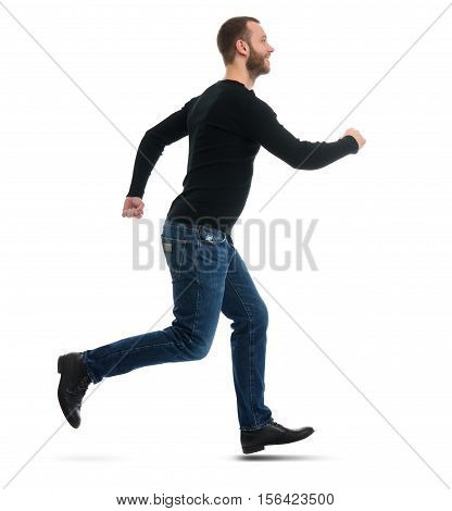Full Length Portrait Of A Smiling Bearded Guy Running