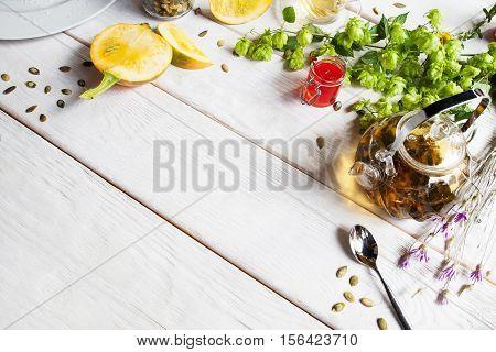 Pumpkin, tea pot and hop frame, free space. Autumn, seasonal, fall inspiration, creative design , healthy food concept